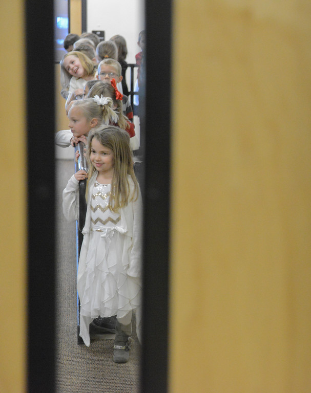 "Justin Sheely | The Sheridan Press<br /> First-grader Adaline Cook waits with her classmates outside the gymnasium during ""Sounds of the Season"" holiday program Tuesday at Woodland Park Elementary School."