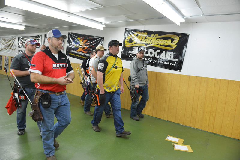 Justin Sheely | The Sheridan Press<br /> Shooters walk down to the targets to collect scores during the 1st Annual Wyoming Open Archery Competition Saturday at Rocky Mountain Discount Sports. The event hosted professional player from the region along with local shooters.