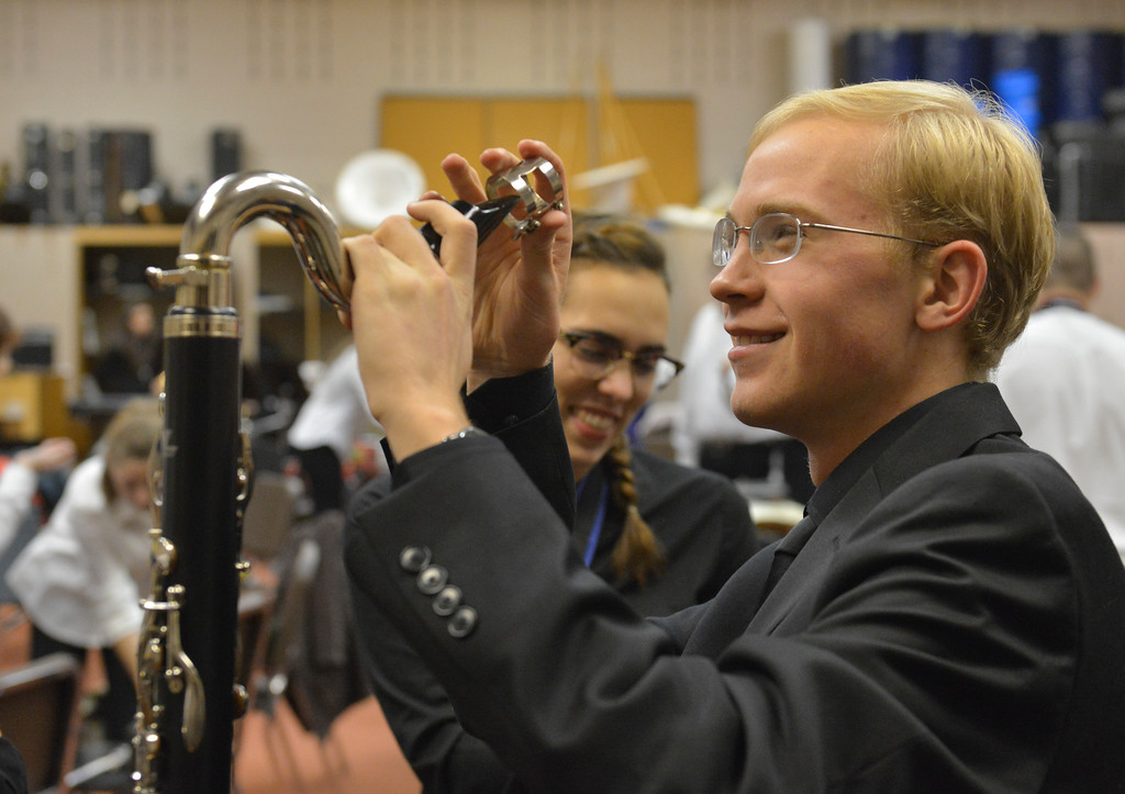 "Justin Sheely | The Sheridan Press<br /> All-State and All Northwest music student Gabe Briggs assembles his Bass Clarinet in the music room prior to the Band Department's ""A Very Merry Christmas"" concert Thursday at Sheridan High School."