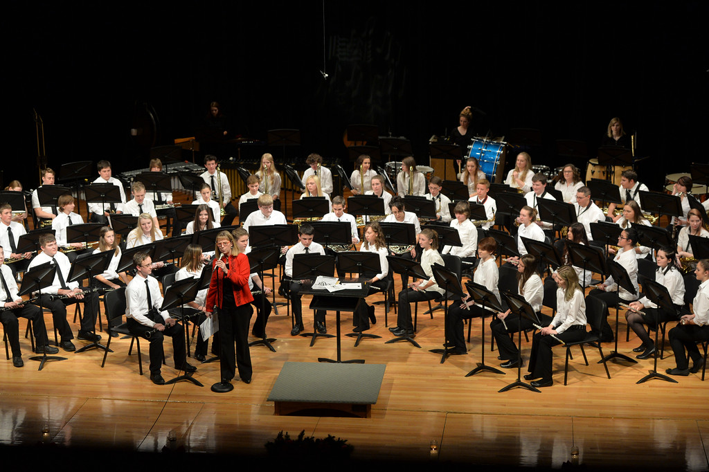 "Justin Sheely | The Sheridan Press<br /> Director Diane Knutson introduces the next song for the Symphonic Band during the Band Department's ""A Very Merry Christmas"" concert Thursday at Sheridan High School."