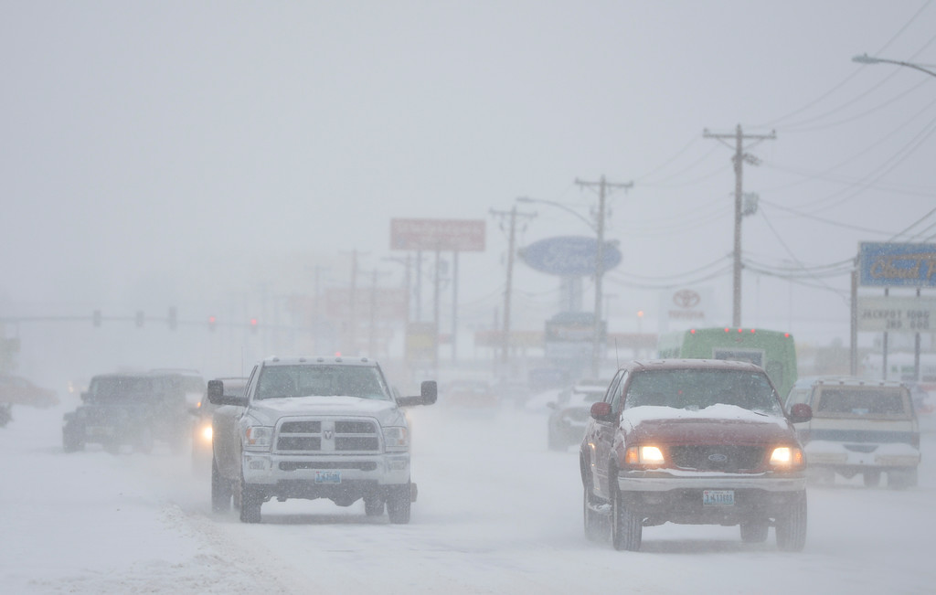 Justin Sheely | The Sheridan Press<br /> Traffic crawls along Coffeen Avenue Friday morning in Sheridan. Snow accumulation reached up to 3 inches Friday morning.