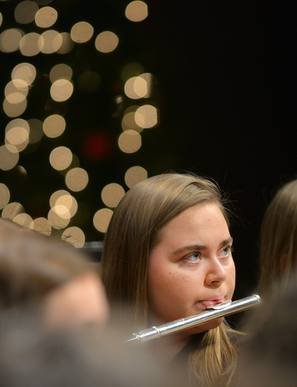 "Justin Sheely | The Sheridan Press<br /> Music student Emma Manor plays the Flute during the Band Department's ""A Very Merry Christmas"" concert Thursday at Sheridan High School."