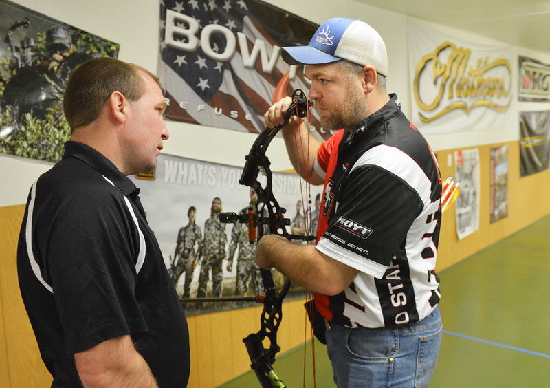 Justin Sheely | The Sheridan Press<br /> Justin Sabol of Billings, Montana, left, visits with professional bow shooter Jeremy Terhune of Gillette, Wyoming, during the 1st Annual Wyoming Open Archery Competition Saturday at Rocky Mountain Discount Sports. The event hosted professional player from the region along with local shooters.