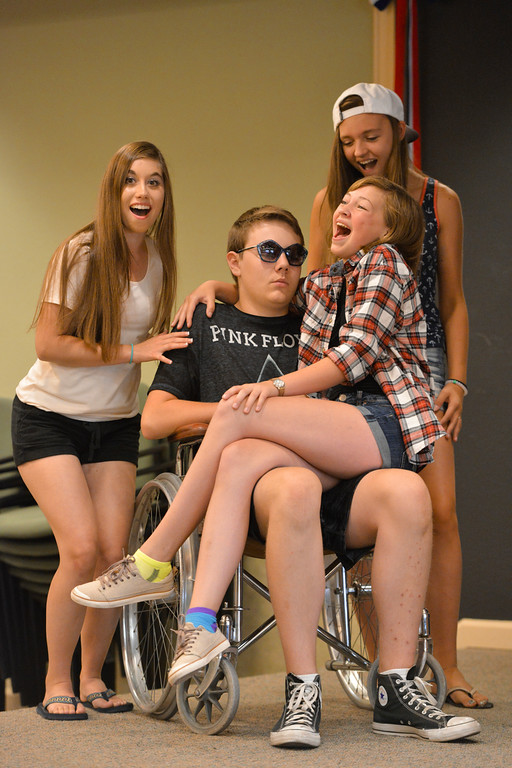"Justin Sheely | The Sheridan Press<br /> Kelly Buchanan, as the body of Mr. Hendon, sits in a wheelchair as southern ladies, from left, Sierra McCoy, Ricci Redman and Mallory Arneson sing during a rehearsal for ""Lucky Stiff"" Tuesday at the Sheridan Senior Center. The show is performed by local teenagers by Funny Face Productions. Showtimes are July 28 at 2 p.m. and 7 p.m., July 30 at 7 p.m. and July 31 at 2 p.m. at the Mars Theater located next to the WYO Theater."