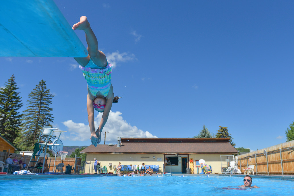 Justin Sheely | The Sheridan Press<br /> Seven-year-old Afton Cummins dives into the pool during swimming lessons Thursday at the public pool in Dayton. The swim lessons are offered by the town of Dayton and the Tongue River Valley Community Center in two-week long sessions in June and July for kids of various skill levels.