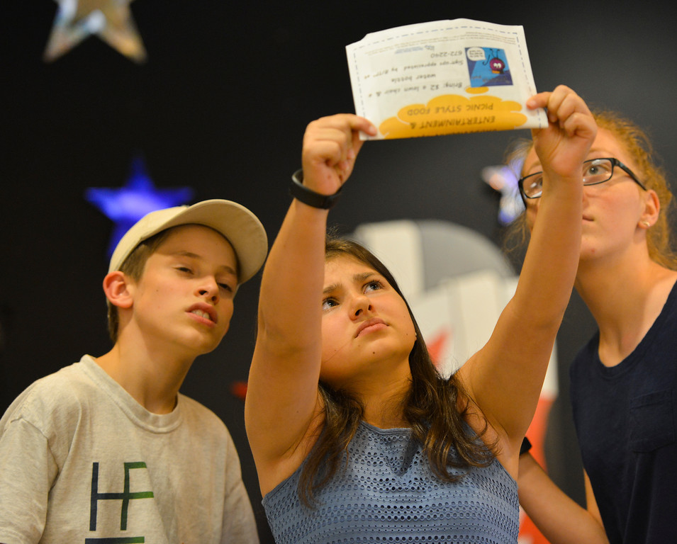 "Justin Sheely | The Sheridan Press<br /> Amaya Cook holds up a mysterious telegram addressed to Mr Witherspoon as Camden Schroth, left, and Claire Schnatterbeck looks on during a rehearsal for ""Lucky Stiff"" Tuesday at the Sheridan Senior Center. The show is performed by local teenagers by Funny Face Productions. Showtimes are July 28 at 2 p.m. and 7 p.m., July 30 at 7 p.m. and July 31 at 2 p.m. at the Mars Theater located next to the WYO Theater."