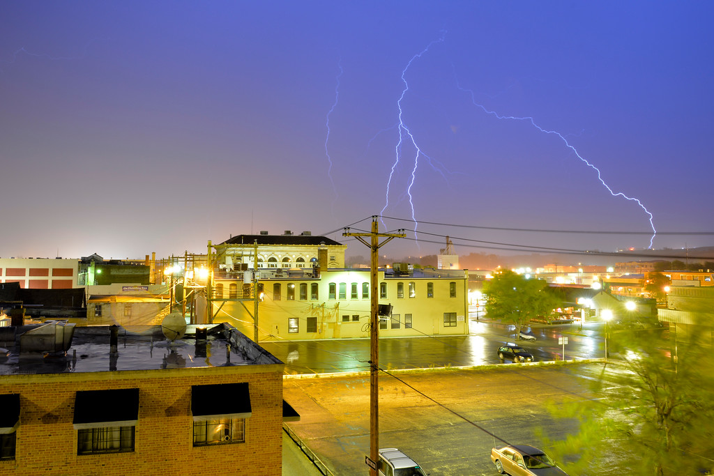 Justin Sheely | The Sheridan Press<br /> Lightning, wind and rain strike Sheridan as seen from the downtown area Wednesday night.