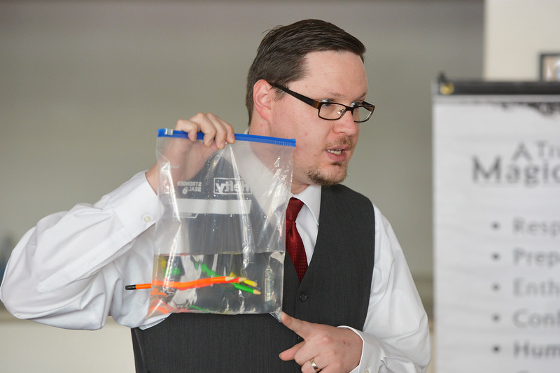 "Justin Sheely | The Sheridan Press<br /> AJ ""The Amazing AJ"" Longhurst reveals the secret to his trick after piercing a water-filled ziplock bag with several pencils without spilling during a preview for AJ's magic academy Wednesday at the WYO Theater. ""The secret is science"" Longhurst explains. Longhurst is starting a magic academy at the Mars Theater to teach life skills to children. Longhurst was inspired to open the magic academy after noticing the prevalence of youth behind computer and phone screens instead of interacting with each other. ""We are raising a generation of screen-agers rather than teenagers, Longhurst said. The Amazing AJ wants to teach life skills, instill confidence and to get today's youth talking face-to-face again through teaching magic tricks. Information about the magic academy is available at online at  <a href=""http://www.ajsmagicacademy.com"">http://www.ajsmagicacademy.com</a>."