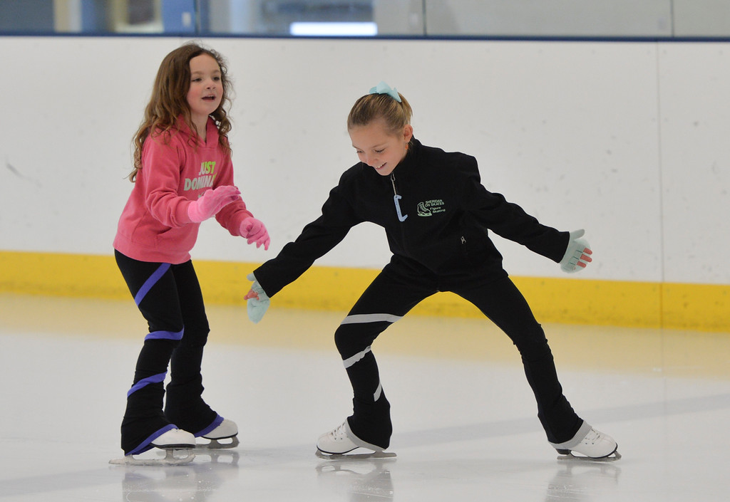 Justin Sheely | The Sheridan Press<br /> Five-year-old Khloe Thomas, left, and Marra Donahue, 8, skate together during the Learn to Skate program Saturday at Whitney Ice Rink in the M&M's Center. Various programs are offered at Whitney Ice Rink, included Learn to Skate, youth and adult hockey leagues and competitive figure skating.