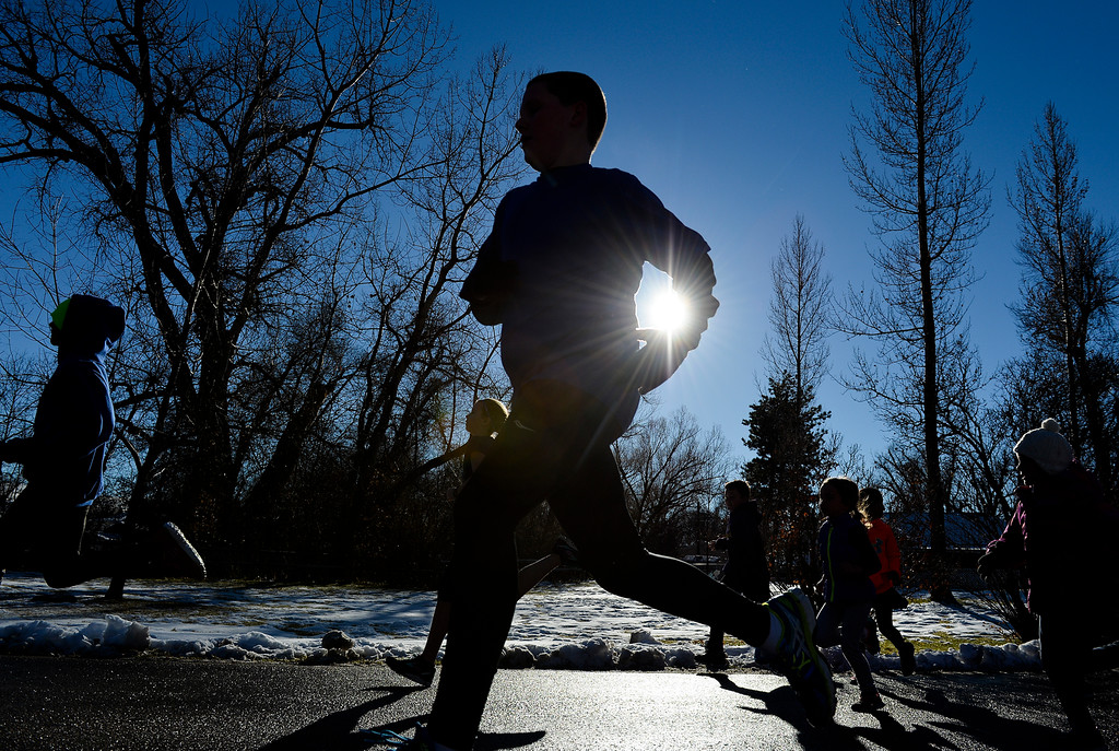 Justin Sheely | The Sheridan Press<br /> Children take off for the 1-mile run during the 38th annual Turkey Trot Thursday morning at Kendrick Park. Proceeds from the event support the Sheridan Junior High School and Sheridan High School Cross Country and Track and Field programs.