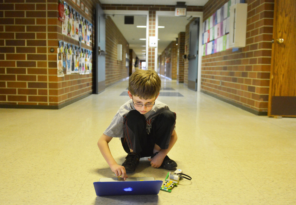 Justin Sheely | The Sheridan Press<br /> Third-grader Logan Whisler starts a program on a laptop to run his Lego machine during an after school Lego Robotics class at Sagebrush Elementary School. The robotics class teaches the children coding and encourages problem solving skills.