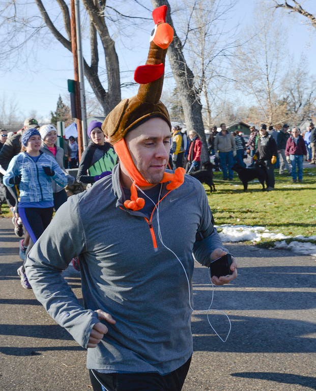 Justin Sheely | The Sheridan Press<br /> Matt Johnson shows his turnkey flare during the 38th annual Turkey Trot Thursday morning at Kendrick Park. Proceeds from the event support the Sheridan Junior High School and Sheridan High School Cross Country and Track and Field programs.
