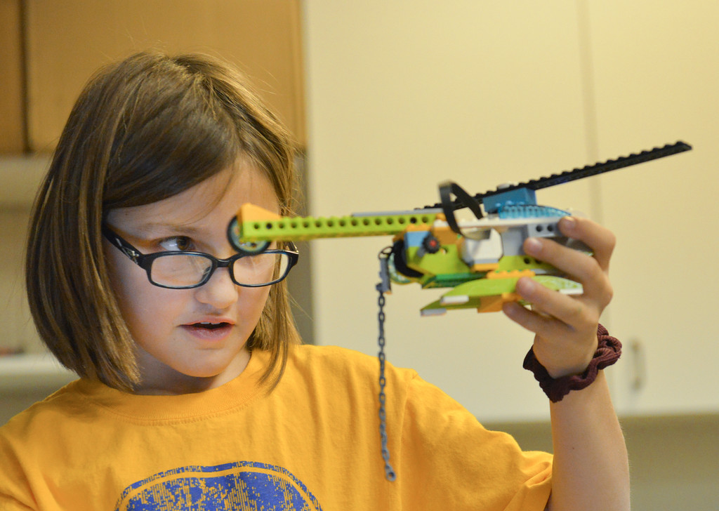 Justin Sheely | The Sheridan Press<br /> Third-grader Adrianna Bly holds up a Lego helicopter during an after school Lego Robotics class at Sagebrush Elementary School. The robotics class teaches the children coding and encourages problem solving skills.