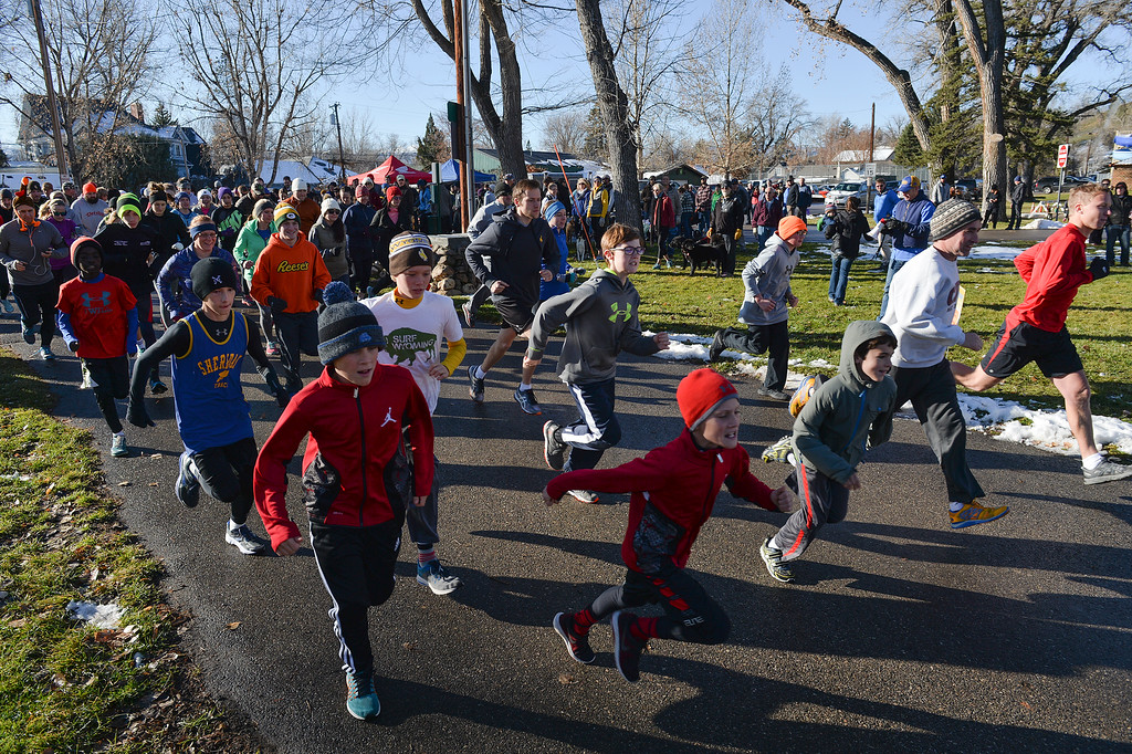 Justin Sheely | The Sheridan Press<br /> Participants leave the starting line during the 38th annual Turkey Trot Thursday morning at Kendrick Park. Proceeds from the event support the Sheridan Junior High School and Sheridan High School Cross Country and Track and Field programs.