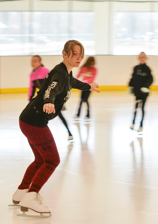 Justin Sheely | The Sheridan Press<br /> Fifteen-year-old Anastasia Beutler glides over the ice during the Learn to Skate program Saturday at Whitney Ice Rink in the M&M's Center. Various programs are offered at Whitney Ice Rink, included Learn to Skate, youth and adult hockey leagues and competitive figure skating.