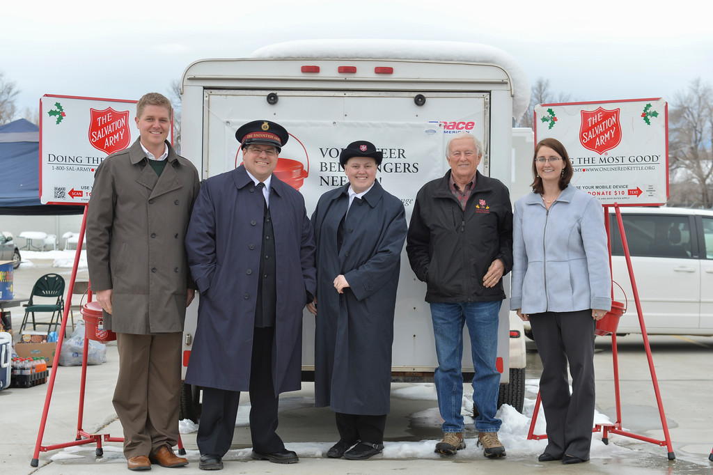 Justin Sheely | The Sheridan Press<br /> The Salvation Army kicks off their 2016 Red Kettle campaign Monday at the Salvation Army Thrift Store on Coffeen Avenue. From left, Ryan Koltiska of the Sheridan County Chamber of Commerce, Lt. Matthew Morrow, Lt. Charleen Morrow, Alan Weakly of the Salvation Army's Advisory Board and Brooke Barney, President of of Sheridan Rotary. The nonprofit organization has a fundraising goal of $80,000 this year.