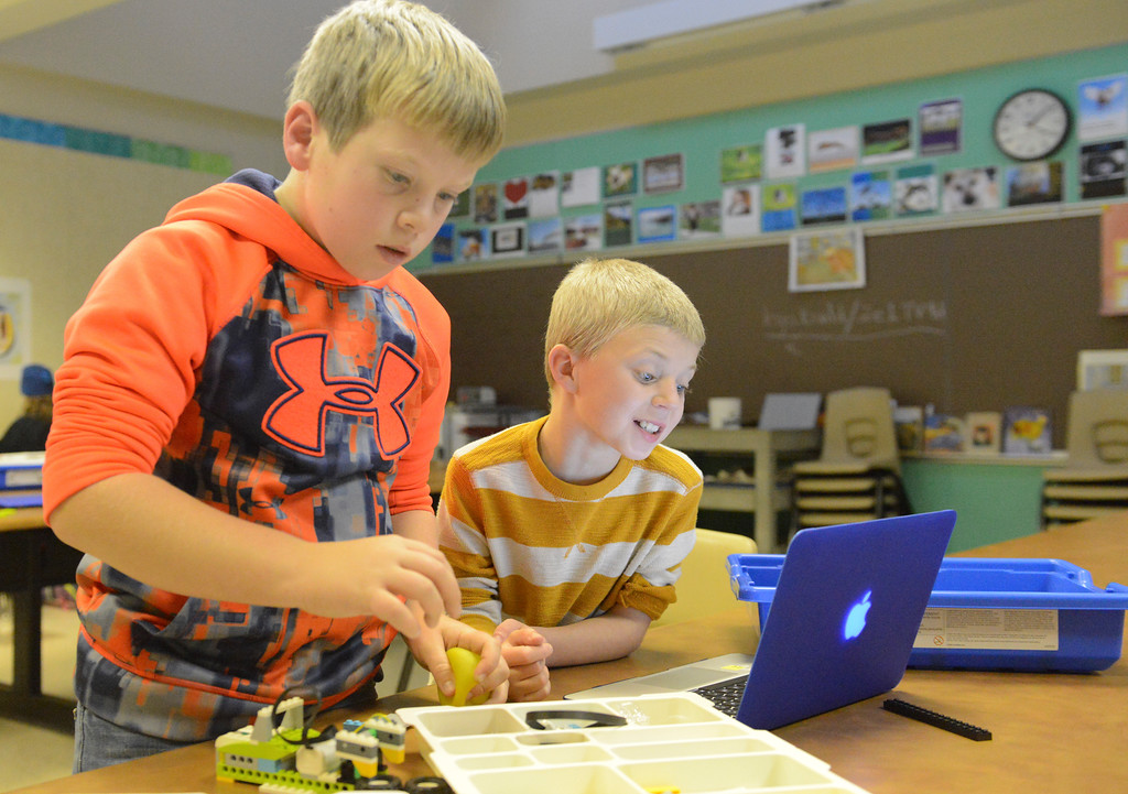 Justin Sheely | The Sheridan Press<br /> Third-grader Brodyn Buchanan, left, and Michael Fleming build a Lego machine during an after school Lego Robotics class at Sagebrush Elementary School. The robotics class teaches the children coding and encourages problem solving skills.