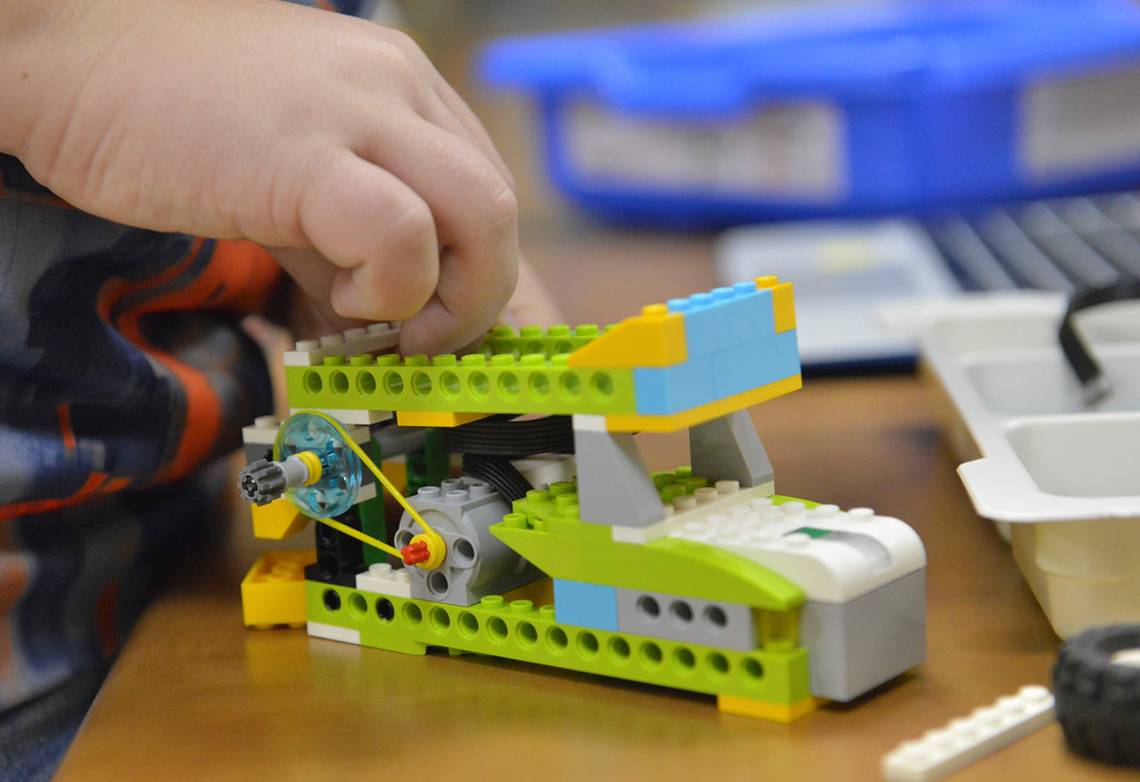Justin Sheely | The Sheridan Press<br /> A student builds up a lego machine during an after school Lego Robotics class at Sagebrush Elementary School. The robotics class teaches the children coding and encourages problem solving skills.