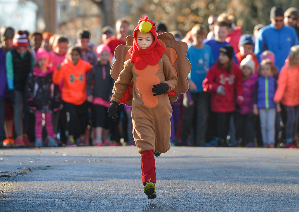 Justin Sheely | The Sheridan Press<br /> Seven-year-old Grayson Moore runs ahead of the children's race during the 38th annual Turkey Trot Thursday morning at Kendrick Park. Proceeds from the event support the Sheridan Junior High School and Sheridan High School Cross Country and Track and Field programs.