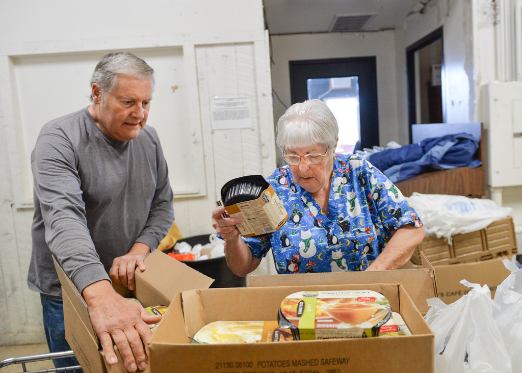 Justin Sheely | The Sheridan Press<br /> Volunteers Daryl Stechcon, left, and Nellie Bechtell load up boxes with items needed for a Thanksgiving Day meal Monday at the People Assistance Food Bank on N. Main Street. The Food Bank's founder Dan Lick died September 30, 2016 – the volunteers are working to honor Lick's vision this holiday season.