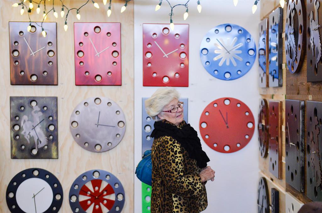 Justin Sheely | The Sheridan Press<br /> Karen Case looks at a wall displaying clocks during the Holiday Bazaar Saturday at the Holiday Inn.