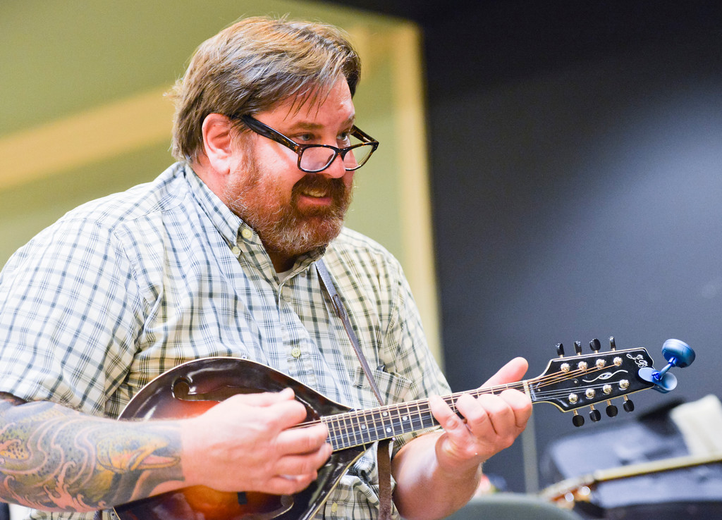 Justin Sheely | The Sheridan Press<br /> Scott Schroder plays the mandolin during the Bluegrass Old Timey Jam Tuesday evening at the Sheridan Senior Center. The musicians meet every third Wednesday at the Senior Center at 7 p.m. to play bluegrass. The event is free and open to the public.