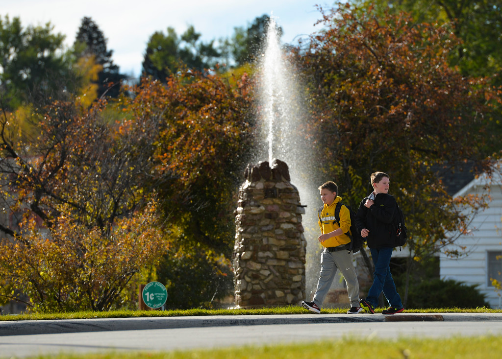 Justin Sheely | The Sheridan Press<br /> Middle school students walk past the old Mill Crook water fountain Tuesday afternoon at Mill Park and Dow Street. The Mill Crook fountain was built in the 1930's but the fountain stopped working around 2012. The City of Sheridan public works department repaired the pipes in July and plans on more improvements to the park including interpretive signs by the fountain. The fountain will be shut off later this week for the winter season.