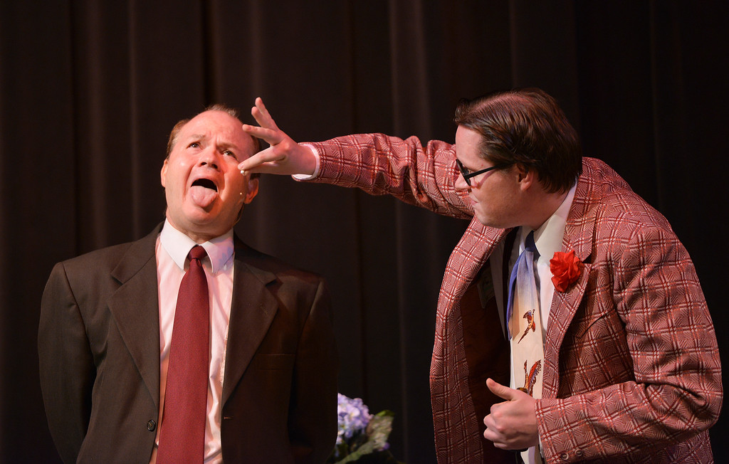"Justin Sheely | The Sheridan Press<br /> Scott Bateman, as Henry Saunders, left, opens his mouth as AJ Longhurst, as Max, pops a pill during a rehearsal to the WYO Theater Gala ""Lend Me a Tenor"" Tuesday at the WYO Theater. The Gala reception is this Saturday at 5 p.m., curtain opens at 7 p.m. Encore performances are Oct. 27 - 29 at 7:30 p.m. and Sunday, Oct. 30 at 2 p.m."
