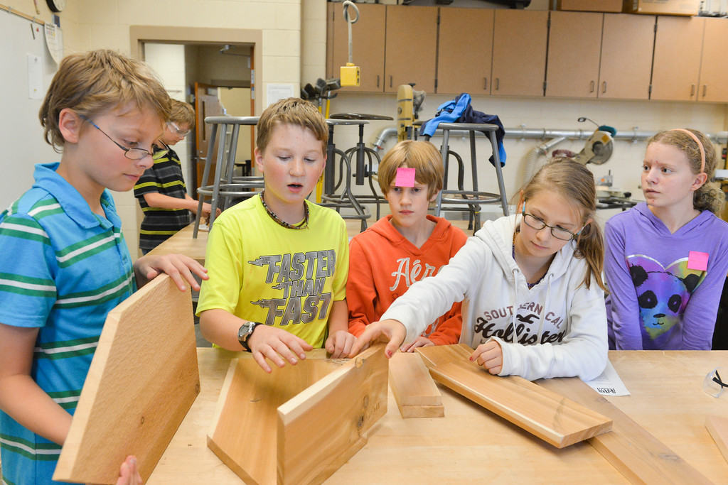 Justin Sheely | The Sheridan Press<br /> Sixth-grade students, from left, Isaiah Coster, Nolan Schaale, Myra Fuhrman, Hailey Elliott and Marly Graham arrange pieces of wood for a bat house building project during the Earth Team After School Program Wednesday at Sheridan Junior High School. The after school program, offered by Sheridan School District 2, focused on the importance of pollinators – insects and other animals that transfer pollen from one plant to another. Local bats play a role in pollination. The students built a bat house modeled after an existing design and plan on installing it outside after painting and other final touches.