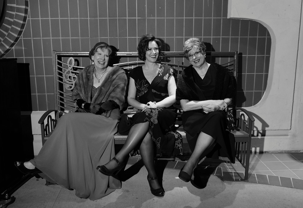 Justin Sheely | The Sheridan Press<br /> From left, Loretta Tonak, Missi Bubert and Sandra Hubert sit on a bench outside the theater during the WYO Theater's Gala Saturday evening at the WYO Theater.