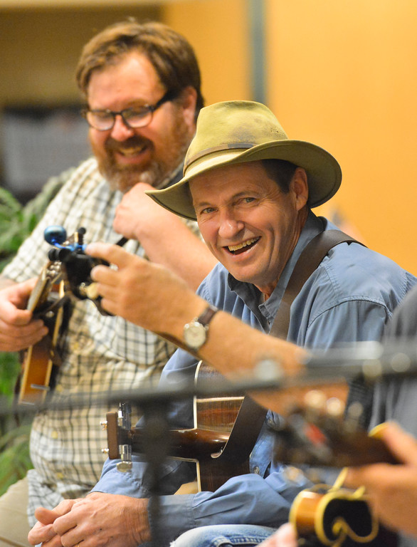 Justin Sheely | The Sheridan Press<br /> Doug Brothers laughs during the Bluegrass Old Timey Jam Tuesday evening at the Sheridan Senior Center. The musicians meet every third Wednesday at the Senior Center at 7 p.m. to play bluegrass. The event is free and open to the public.