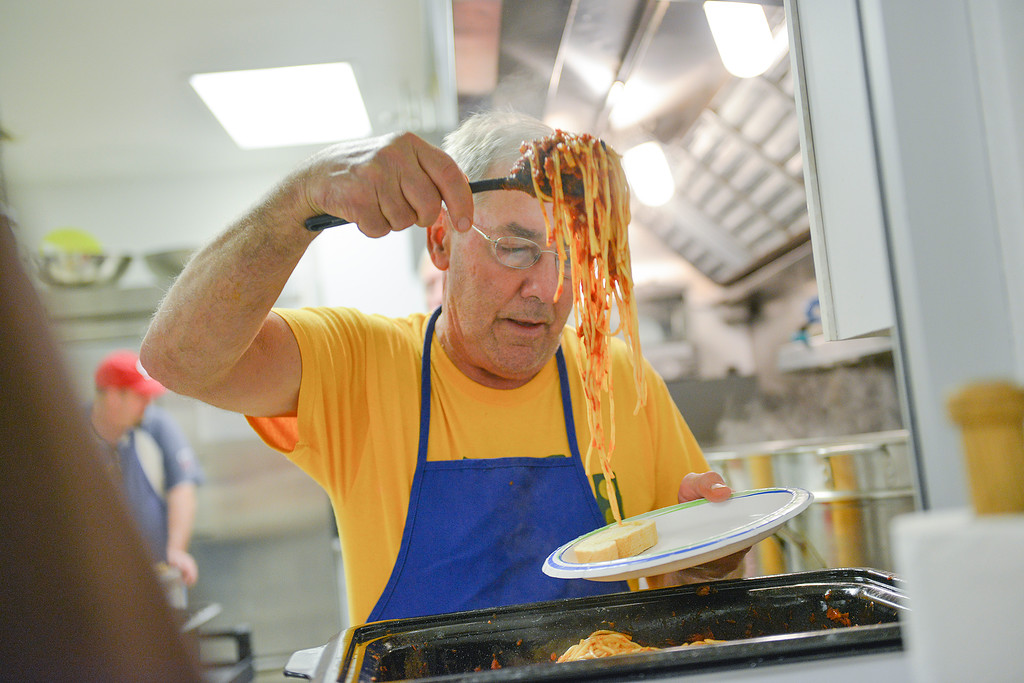 Justin Sheely | The Sheridan Press<br /> Paul Schneider serves spaghetti for a guest during the Spaghetti Dinner Thursday at the Knights of Columbus in Sheridan. The proceeds of the event benefits Legacy Pregnancy Center.
