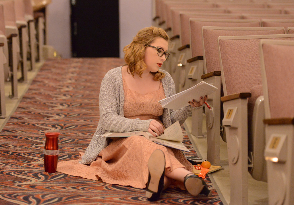 "Justin Sheely | The Sheridan Press<br /> Riley Griffith does her homework in costume during a rehearsal to the WYO Theater Gala ""Lend Me a Tenor"" Tuesday at the WYO Theater. The Gala reception is this Saturday at 5 p.m., curtain opens at 7 p.m. Encore performances are Oct. 27 - 29 at 7:30 p.m. and Sunday, Oct. 30 at 2 p.m."