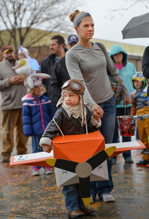 Justin Sheely | The Sheridan Press<br /> Four-year-old Jaxon Filkins waits with his mother Ashli Filkins during the Sheridan Jaycees Halloween Parade Saturday outside of City Hall in downtown Sheridan. Dozens of participants came to the parade despite the rain.