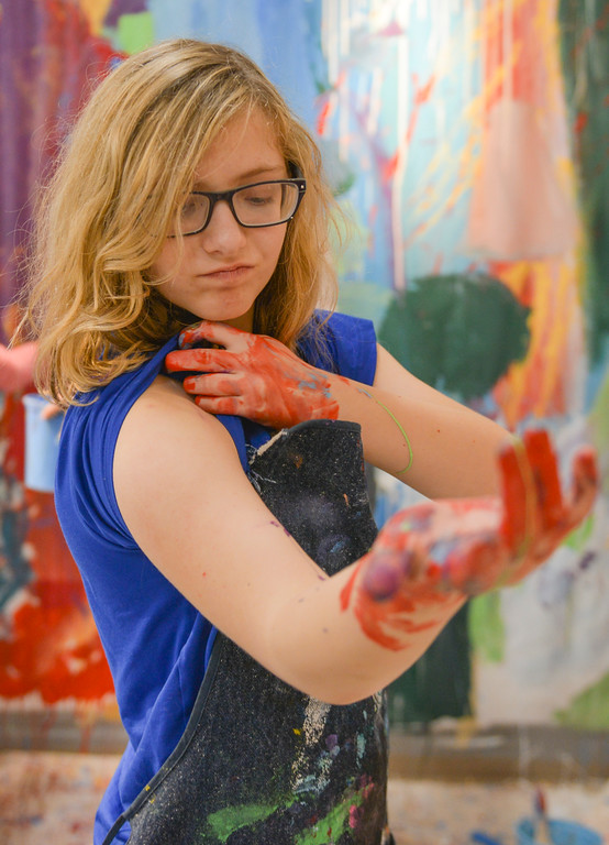 Justin Sheely | The Sheridan Press<br /> Sheridan Junior High School student Anna Vanderhoef rolls back her sleeve during an abstract workshop Thursday in the Whitney Center for the Arts building at Sheridan College. Art instructor Jason Lanka lead a presentation on abstract art and assigned the students to pick complex emotions and create an abstract painting that would convey that emotion. The junior high students were also shown examples in Neltje's work, which is on display throughout the halls of the art center. The workshop is part of an outreach effort by art instructors at the college. The junior high students' work is on display in the Neltje Student Gallery at the Whitney Center for the Arts and open to the public through November 15.