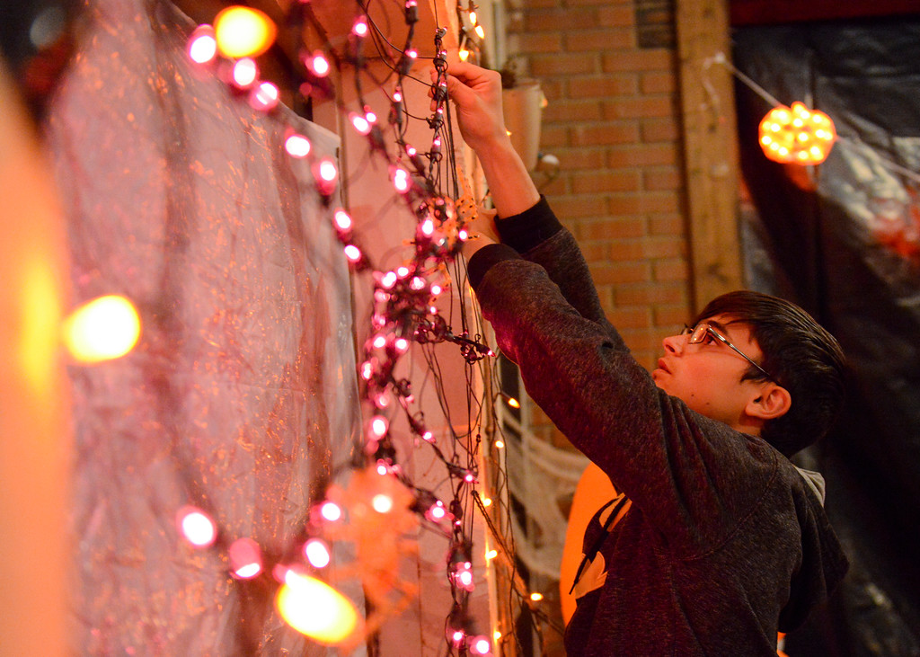 Justin Sheely | The Sheridan Press<br /> Sixteen-year-old Jade Hotchkin hangs up lights for the little kids' room during the Boy Scouts' annual Haunted House Tuesday night at the old Sheridan Iron Works Building. The Boy Scout Troop 117 is hosting the haunted house this weekend, Oct. 28 - 30, from 7 p.m. to 10 p.m. at Sheridan Iron Works. Cost is $5 for children ages 8 and older or $3 for those age 7 and younger. There is no charge for adults accompanying younger children. The haunted house supports Troop 117 for their trip to Jamboree.