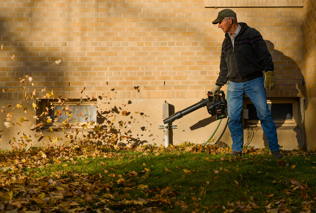 Justin Sheely | The Sheridan Press<br /> Holy Name Catholic Church grounds keeper Phil Klebba uses a leaf blower early Wednesday morning at the priest's house. Chance of rain is expected Friday night and Saturday.