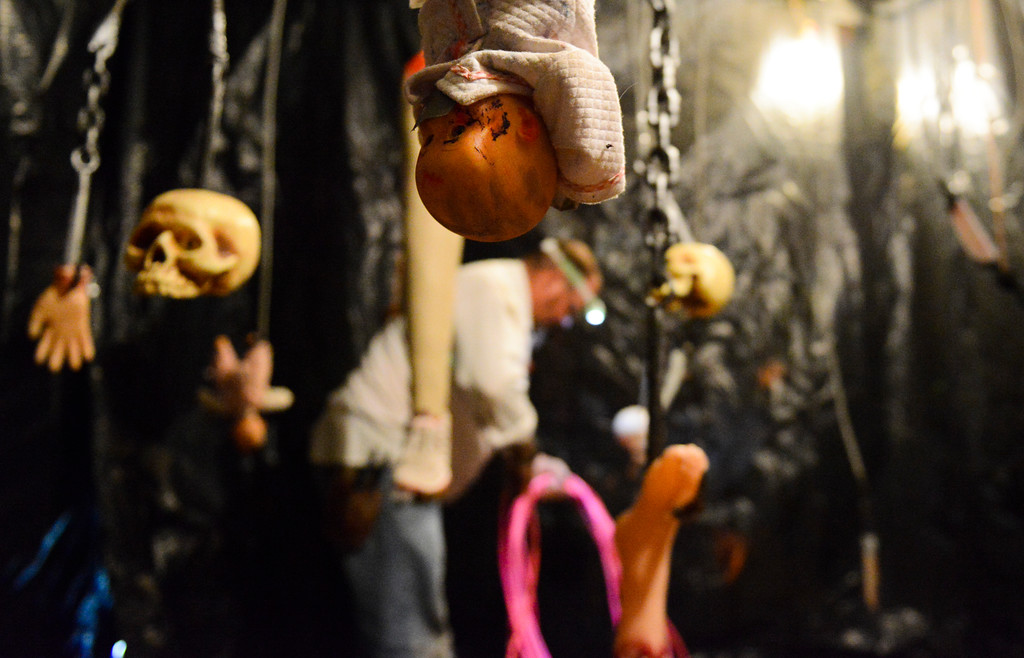 Justin Sheely | The Sheridan Press<br /> A man wraps up a power cord during the Boy Scouts' annual Haunted House Tuesday night at the old Sheridan Iron Works Building. The Boy Scout Troop 117 is hosting the haunted house this weekend, Oct. 28 - 30, from 7 p.m. to 10 p.m. at Sheridan Iron Works. Cost is $5 for children ages 8 and older or $3 for those age 7 and younger. There is no charge for adults accompanying younger children. The haunted house supports Troop 117 for their trip to Jamboree.