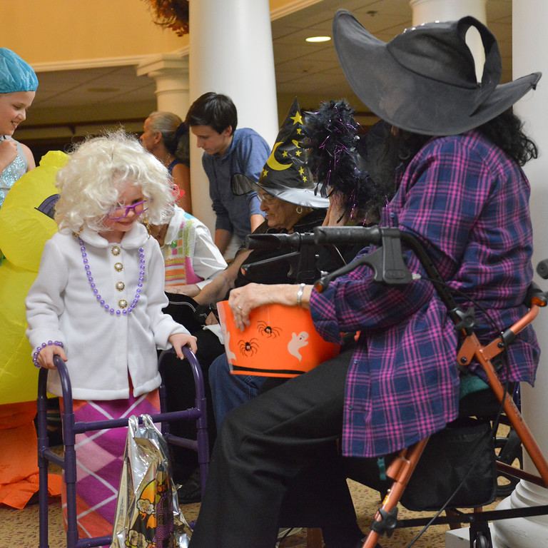 Justin Sheely | The Sheridan Press<br /> Five-year-old Jazmine Chase goes trick-or-treating during Halloween at Sugarland Ridge Thursday evening. Brookdale residents gathered to hand out candy, provide games and activities for the children of the community to enjoy for free.