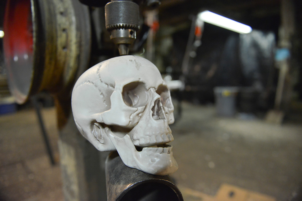 Justin Sheely | The Sheridan Press<br /> A plastic skull is seen in a press drill during the Boy Scouts' annual Haunted House Tuesday night at the old Sheridan Iron Works Building. The Boy Scout Troop 117 is hosting the haunted house this weekend, Oct. 28 - 30, from 7 p.m. to 10 p.m. at Sheridan Iron Works. Cost is $5 for children ages 8 and older or $3 for those age 7 and younger. There is no charge for adults accompanying younger children. The haunted house supports Troop 117 for their trip to Jamboree.
