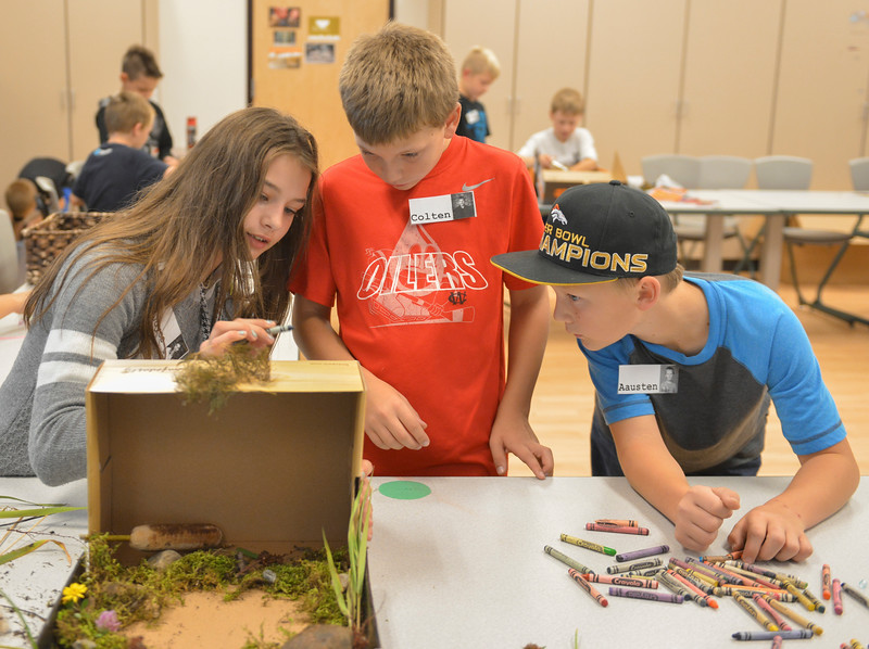 Justin Sheely | The Sheridan Press<br /> Fifth-graders, from left, Joyce Allen, Colten Terry, and Aausten Sticka work on their diorama during an after school program Wednesday at Coffeen Elementary School. The activity was lead by Joey's Flyfishing as part of a 6-week course, twice a week. The nonprofit organization had previously took the students to a local pond to learn about fish habitat and the students gathered materials to use for their diorama projects to illustrate the ecology.