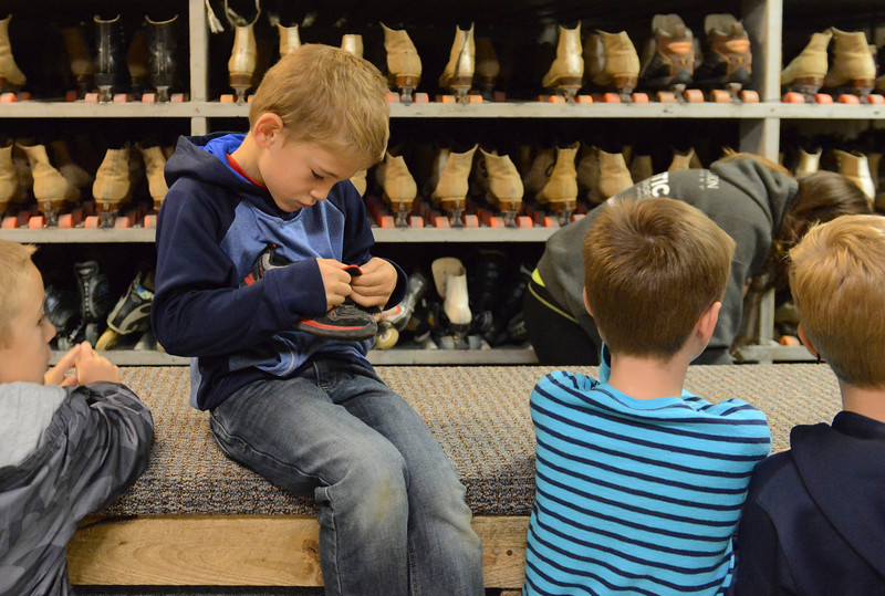 Justin Sheely | The Sheridan Press<br /> First-grader Finn Stalick checks his shoes before checking out a pair of skates during the YMCA's Big Horn Fun Day Friday at Scotty's Skate Castle. The YMCA's Fun Friday program provides fun activities for elementary students in the Big Horn district since Sheridan County School District 1 does not have class on Fridays.
