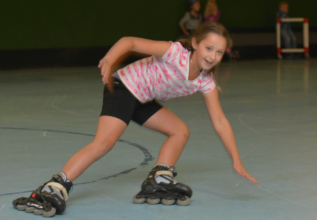 Justin Sheely | The Sheridan Press<br /> Second-grader Avery Nikirk falls down in her roller blades during the YMCA's Big Horn Fun Day Friday at Scotty's Skate Castle. The YMCA's Fun Friday program provides fun activities for elementary students in the Big Horn district since Sheridan County School District 1 does not have class on Fridays.