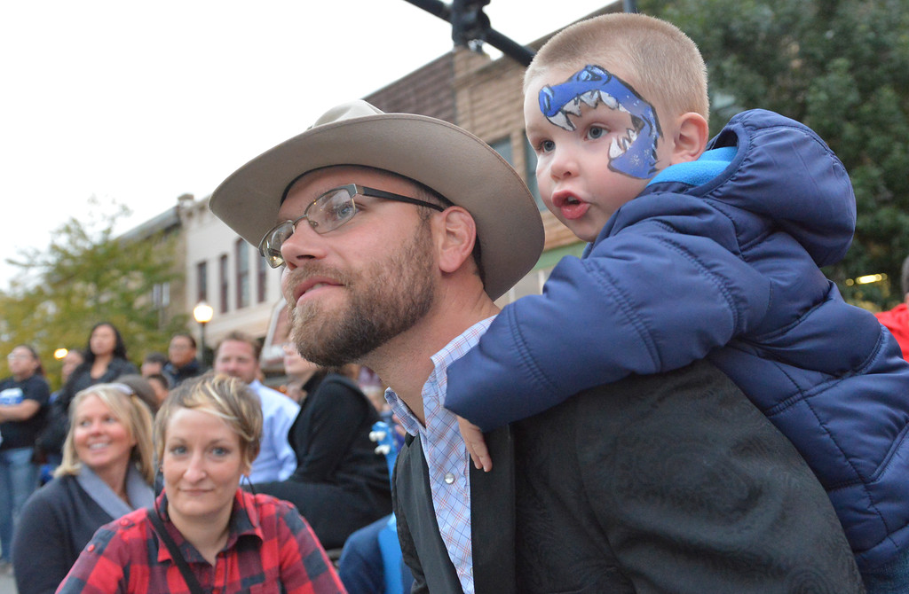 Justin Sheely | The Sheridan Press<br /> Three-year-old Javi Craft climbs on JT Craft during the final Third Thursday Street Festival on Main Street.