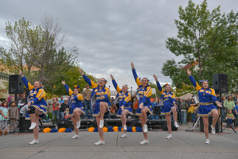 Justin Sheely | The Sheridan Press<br /> The Sheridan High School cheerleading team performs before an audience during the final Third Thursday Street Festival on Main Street.