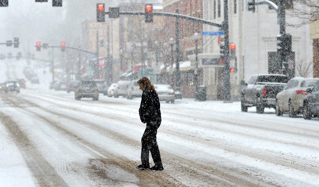 Justin Sheely | The Sheridan Press<br /> Snow falls as a woman crosses Main Street Tuesday morning in Sheridan. Sheridan County can expect snow accumulation from 3 to 6 inches according to a winter weather advisory issued by The National Weather Service of Billings, Montana.