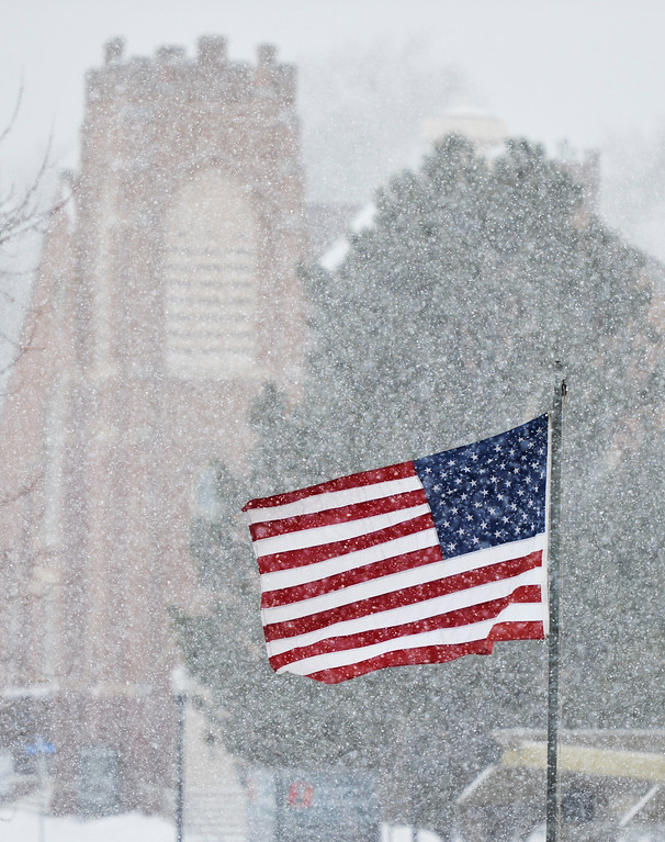 Justin Sheely | The Sheridan Press<br /> The national flag hangs in the air as snow falls Tuesday morning in Sheridan. Sheridan County can expect snow accumulation from 3 to 6 inches according to a winter weather advisory issued by The National Weather Service of Billings, Montana.