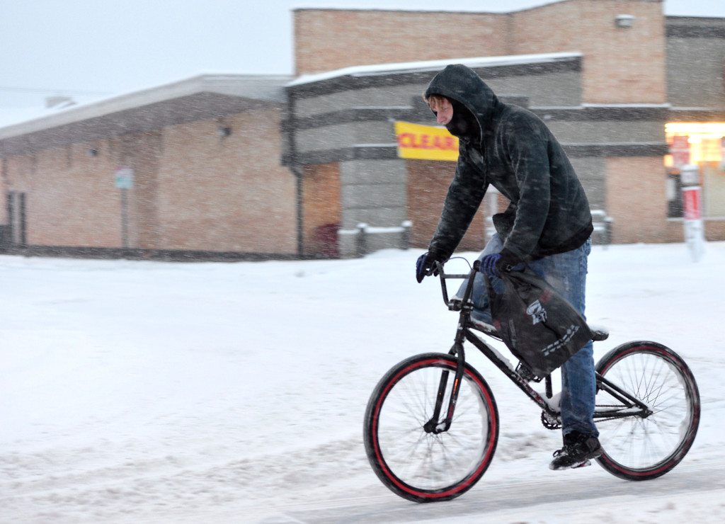 Justin Sheely | The Sheridan Press<br /> A bicyclist spins up a snowy Broadway Street Tuesday evening in Sheridan. Up to ten inches of snow accumulation was reported in parts of Sheridan County.