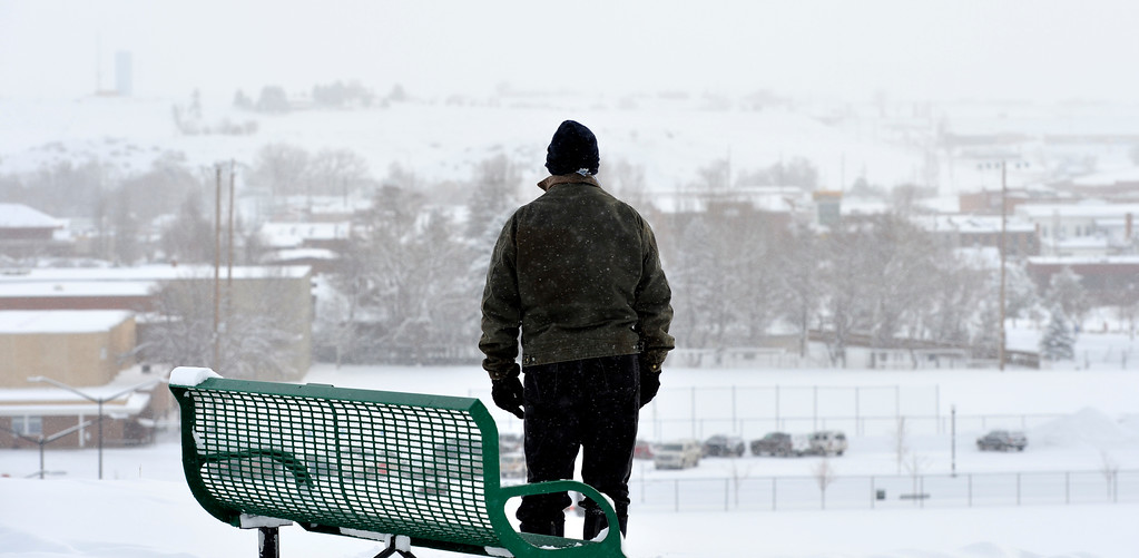 Justin Sheely | The Sheridan Press<br /> A walker looks at the view from the hill at Kendrick Park Wednesday morning. Up to ten inches of snow accumulation was reported in parts of Sheridan County.