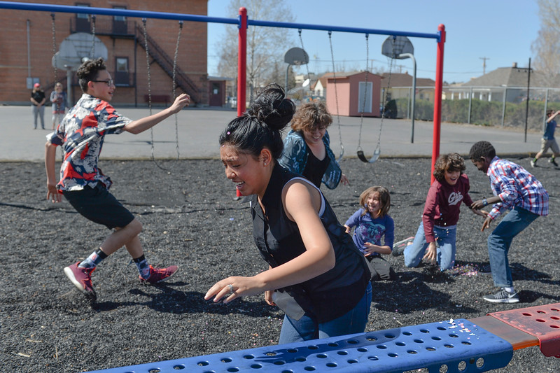 Justin Sheely | The Sheridan Press<br /> Silvia Garza runs away during a hunt for Mexican Cascarones Easter Eggs Thursday at Holy Name Catholic School. Students from spanish language studies made the cascarones by emptying eggs then filling them with confetti. The confetti-filled eggs are part of hispanic tradition that involves cracking the eggs over a person's head. The showering of the confetti is said to bring good luck and good fortune to the recipient. In a religious context, the eggs represent the empty tomb and the resurrection of Jesus.